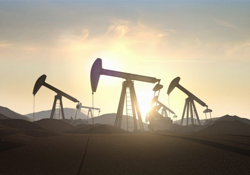 Realistic 3D rendered Oil Rigs in the desert with a beautiful sun flare in the background.